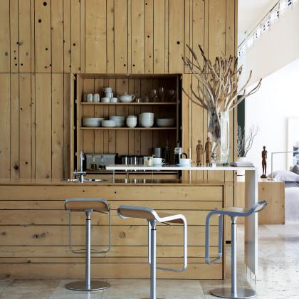 bleached oak-panelled walls