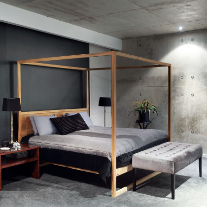 timber four-poster bed