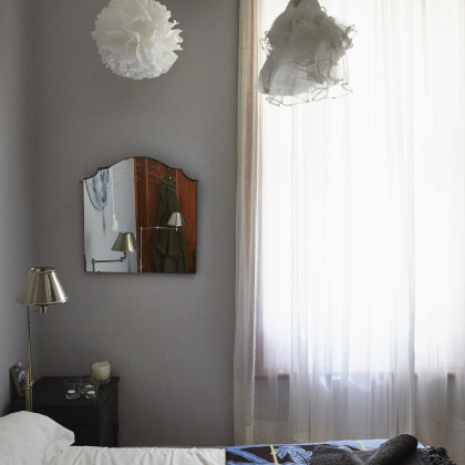 muslin drapes chrome bedside lamp
